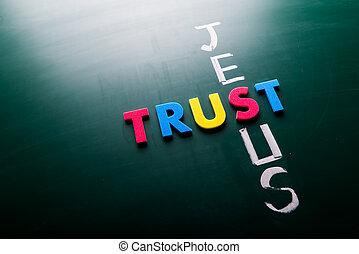 Trust Jesus concept, words on blackboard