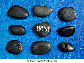 """Trust stones - engraved stone with word \""""trust\"""" in the..."""