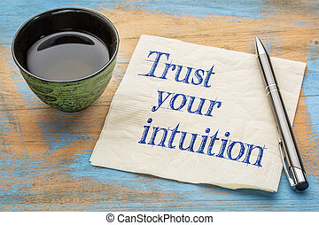 Trust your intuition reminder - handwriting on a napkin with...