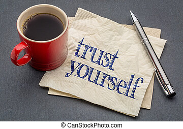 Trust yourself advice - handwriting on a napkin with a cup of coffee