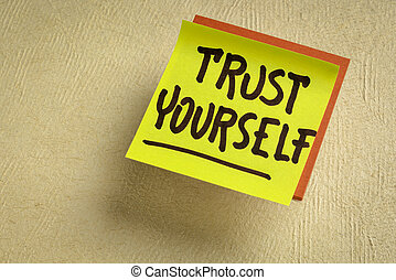 trust yourself reminder note - handwriting on a sticky note against textured handmade paper, mindset and self confidence concept