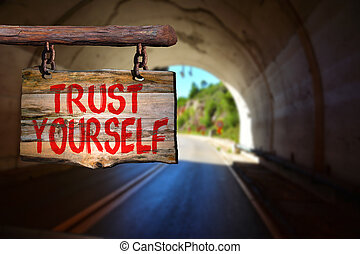 Trust yourself sign on blurred background