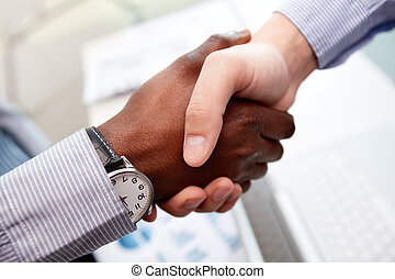 Trustful - Close-up of businessmen shaking hands, Caucasian...