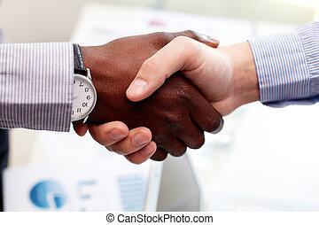 Trustful - Close-up of businessmen shaking hands, Caucasian...