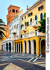 A Photograph of Portuguese Buildings. Bright and contrasting colors.