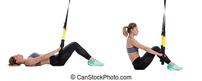 TRX assisted sit-up - Athletic woman performing a functional...