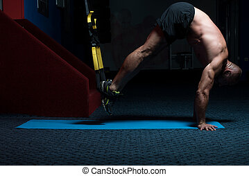 Trx Straps Training - Attractive Man Does Push Ups With Trx...