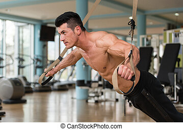 Trx Straps Training - Attractive Man Does Crossfit Push Ups...