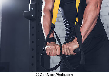 TRX Suspension Training - cropped shot of man exercising...