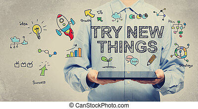 Try New Things concept with man holding a tablet - Try New...