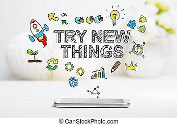 Try New Things concept with smartphone on white table