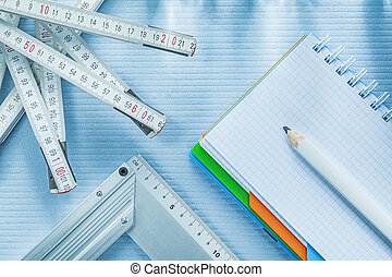 Try square checked notepad pencil tape measure.