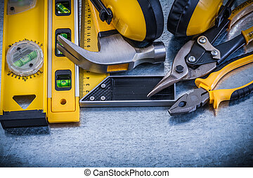 Try square construction level claw hammer pliers steel cutter earmuffs.