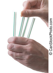 Trying to decide - drawing straws to demonstrate decision...