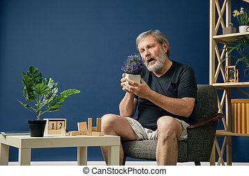 Old bearded man with alzheimer desease - Trying to find...