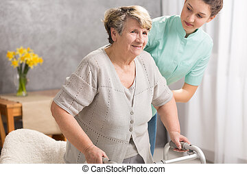 Trying to live normal despite disability - Senior woman with...