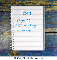TSH - thyroid-stimulating hormone text written in notebook