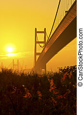 Tsing Ma Bridge in Hong Kong at sunset