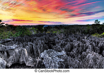 Beautiful stacked image at sunset of the unique landscape at the Tsingy de Bemaraha Strict Nature Reserve in Madagascar