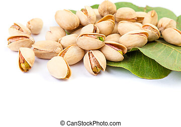 Tsty pistachio nuts with leaves isolated on white background