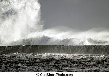 Tsunami - Big storm wave against harbor of Vila do Conde, ...
