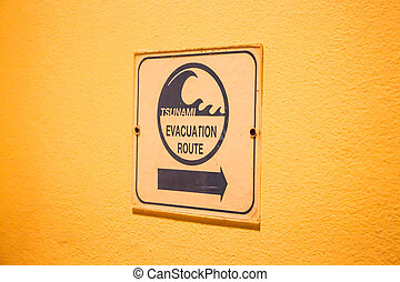 Tsunami evacuation route sign on up stair way
