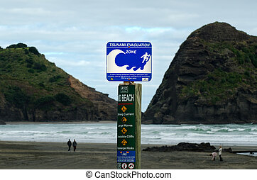 Tsunami evacuation route sign - PIHA, NZ - MAY 30:Tsunami...
