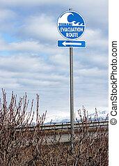 Tsunami evacuation route sign - A blue and white Tsunami...