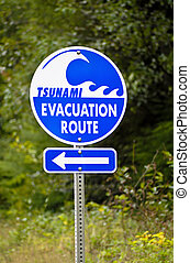 Tsunami Evacuation Route Sign - A highway sign marking...