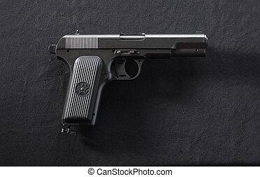 TT pistol. - Soviet gun TT on black background. Pneumatic.