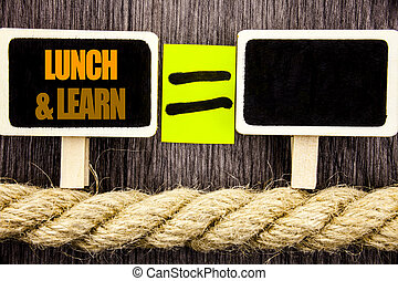Ttext showing Lunch And Learn. Business concept for Presentation Training Board Course written on Blackboard Equation space for your text on the wooden background.