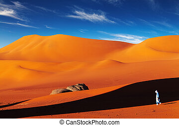 Sahara Desert, Algeria - Tuareg in desert at sunset, Sahara...