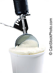 Tub of vanilla ice cream with a scoop