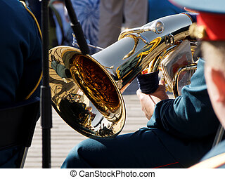 Tuba in the hands of a brass band musician