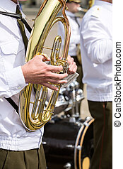 Tuba player in military band
