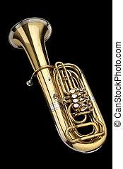 Tuba wind instrument. On a black background