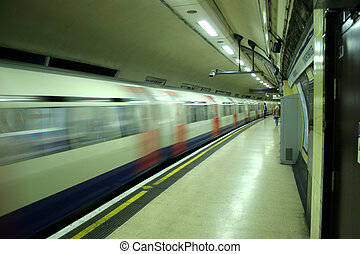 Tube Train - tube train pulling out of the station, motion...