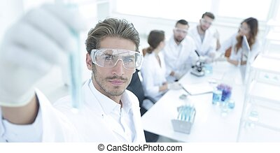 tube with reagents on blurred background laboratory.the...