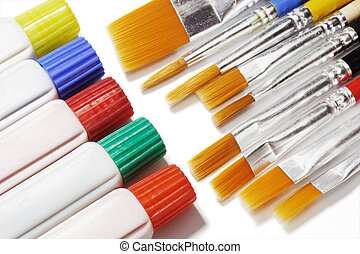 Tubes of color paints and brushes