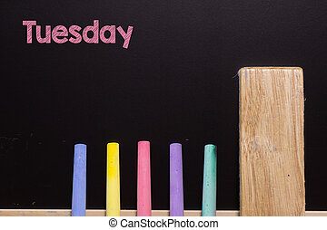 Tuesday on Blackboard with chalk and eraser