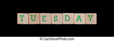 Tuesday spelled out in old wooden blocks