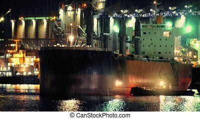 Tug And Ship Near Refinery - Tug guiding large oil tanker...