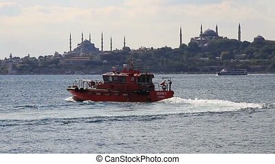 Tug boat maneuvering in front of Istanbul City