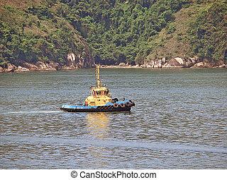 tug boat on the sea and mount backwards