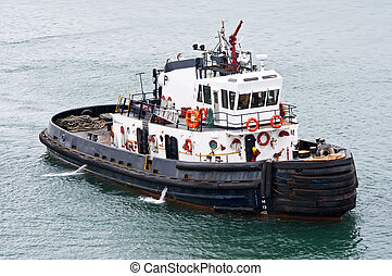 Tug boat ready to help ships - A tug boat stands ready to...
