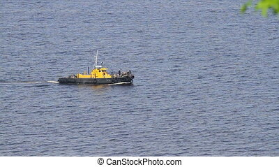 Tug boat sails on a sea in Ukraine