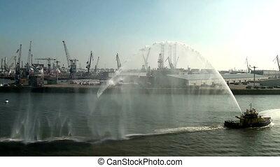 Tug boat splashing water-Rotterdam