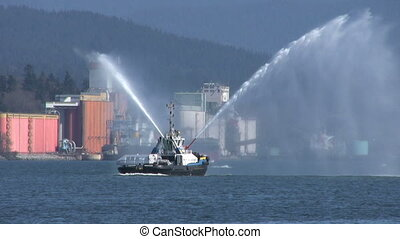 Tug Boat Spraying Water Backwards