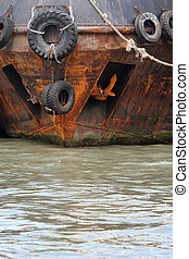 tug boat - scrap tires as a shield on the tug boat