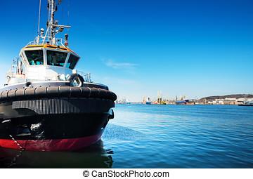 Tug ship - Small tug ship in port, Gdansk / Poland. Shipyard...